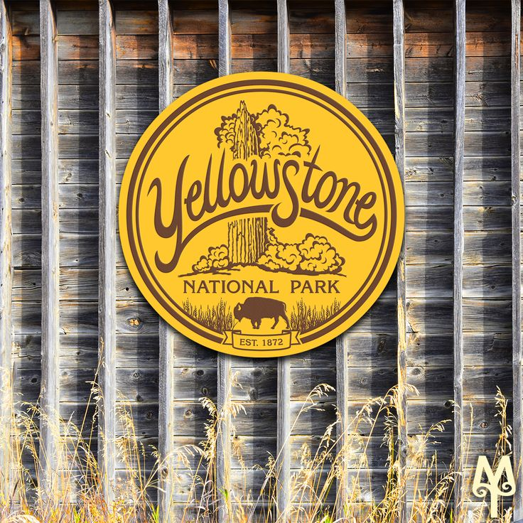 A sharp looking 42 inch Yellowstone National Park sign (by Montana Treasures) hangs on a barn just outside of Bozeman, Montana. New  cabin decor signs come in 14, 28, 36, and 42 inch diameters. Shop now!