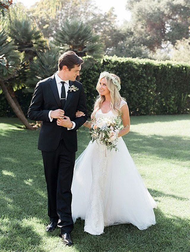 Ashley Tisdale's wedding gown was elegant and simple. We love how she added a bohemian touch with her floral crown.