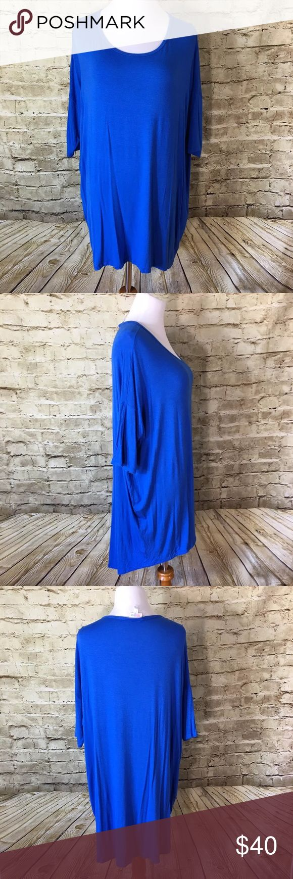 "Lularoe Cobalt Blue Irma Hi Low Name Brand: Lularoe  Condition: Pre Owned, Excellent condition light wear, no holes, stains or flaws to note  Size: Large (see measurements)  Color: Blue  Style: Irma  Material: 95% Rayon 5% Spandex   Always check the measurements, label sizes are not consistent.   Measurements are approximate, and are of item laying flat and unstreched: Length:31-37 "" Bust:31"" Sleeve: 6"" LuLaRoe Tops Tees - Short Sleeve"