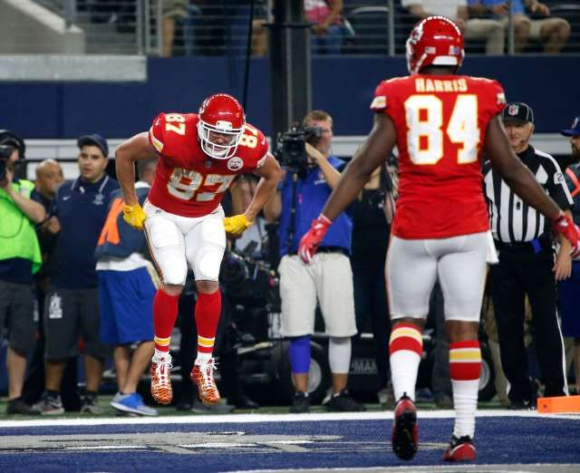 Best NFL celebrations of 2017 - November 15, 2017:  Kansas City Chiefs tight end Travis Kelce (87) pretends to participate in a sack race as he celebrates catching a touchdown pass as tight end Demetrius Harris (84) watches in the second half of an NFL football game against the Dallas Cowboys on Sunday, Nov. 5, 2017, in Arlington, Texas.