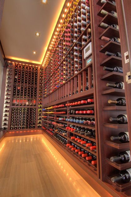 LED strip lighting (which will not heat up the wine)  contemporary wine cellar by London Audio Ltd