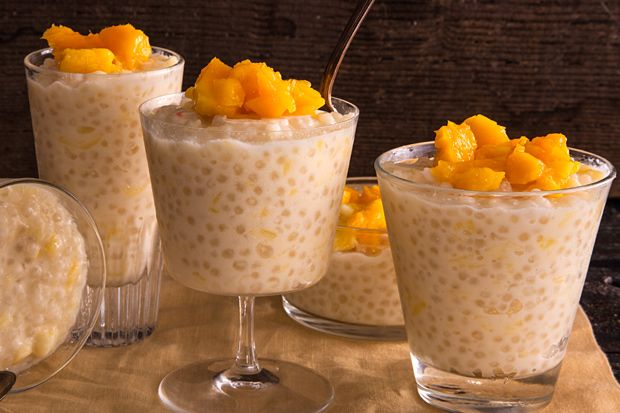 For this mango tapioca pudding recipe you will need coconut oil, coconut milk, sugar, pearl tapioca, egg, pineapple, mango, and flaked sweetened coconut.