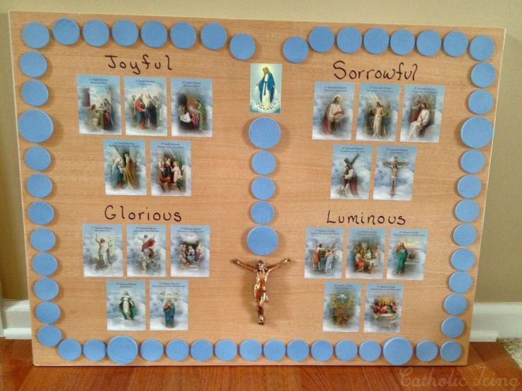 """How to make a Rosary board to use with kids. Move a Mary statue around to the different """"beads"""" as you pray. Such a cute idea!"""