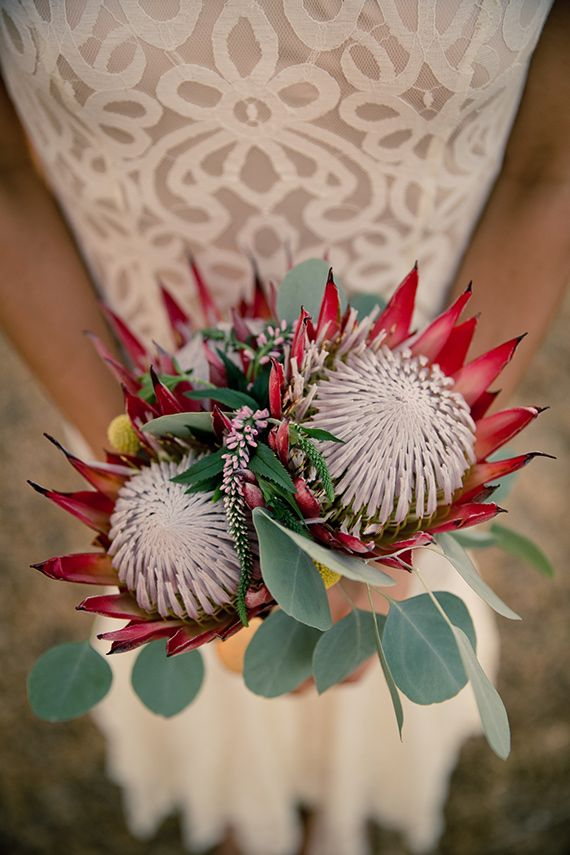 Proteas, Silver Dollar Eucalyptus, Pink Veronica bridal bouquet| Photo by Gary Ashley of Wedding Artist Collective | Read more - http://www.100layercake.com/blog/?p=67588