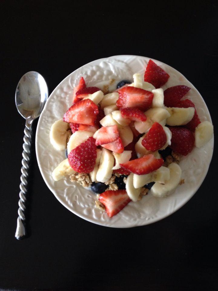 vanilla yogurt parfait w/ granola strawberries blackberries blueberries and bananas