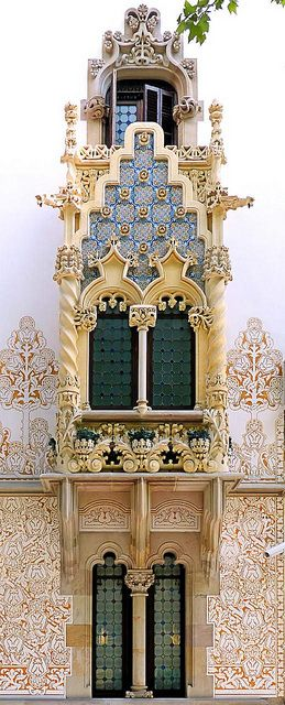 Casa Macaya, Barcelona, Spain. Declared a Cultural Asset of National Interest, the Macaya house was finished in 1901. The architect, Josep Puig i Cadafalch, revived the grandiose of the Gothic style with his design of the facade. Arches  columns are intricately carved  decorated by ironwork next to white stucco walls with elaborately engraved designs.