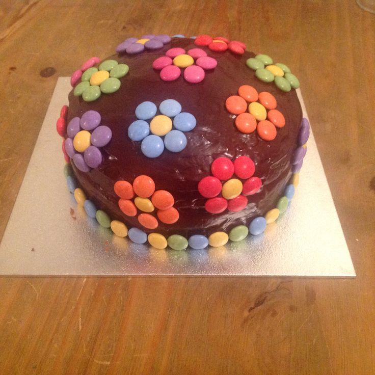 Chocolate Cake with smarties flowers. Chocolate ganache topping, chocolate buttercream filling. Mmmmmm.