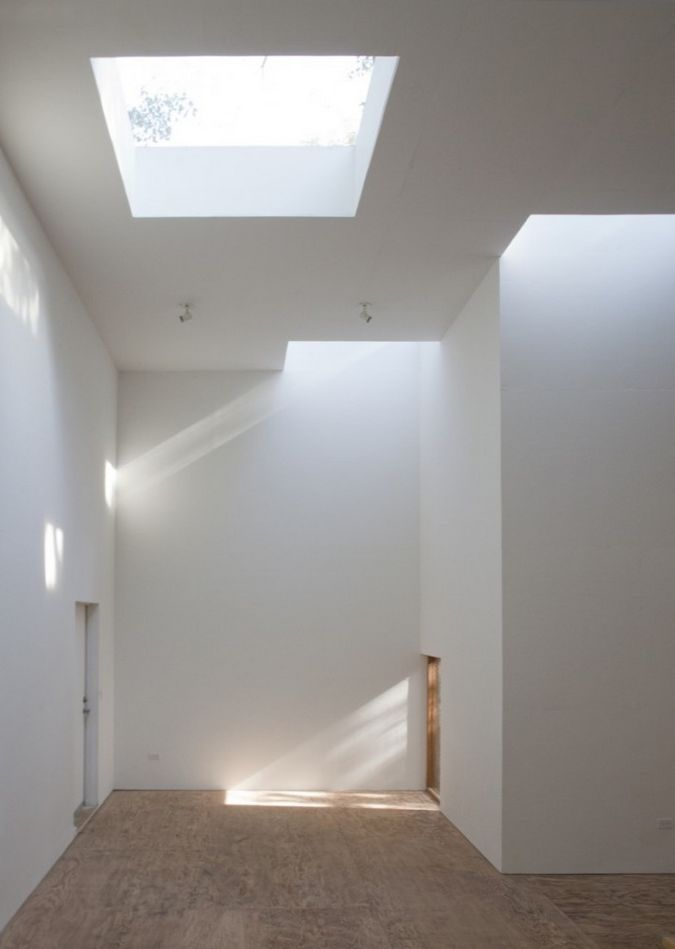 Steven Holl, T Space Gallery, interior skylights, entire building is lined with plywood, the walls are painted plywood, the floor is sanded marine plywood