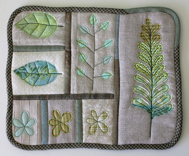 Leaf Sampler Trivet by Laurraine Yuyama/Patchworkottery    Testing out my new raw edge applique technique. I place the scraps over the quilted block, free-motion machine quilt some shapes and cut away the excess fabric after! I'm horrible at following edges and this way gives me freedom!