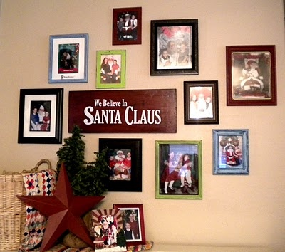 love this idea! - Framing all the pictures with santa for a wall - so darling!