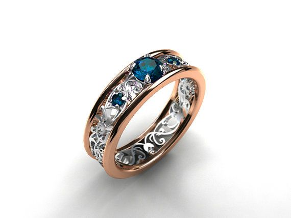 Stunning teal diamonds and delicate filigree design of this ring is a gorgeous match. This ring has 14k rose gold outer bands and 14k white