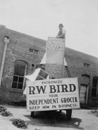 Robert William Bird standing on top of an advertisement for his Canoga Park grocery store, 1937. Canoga-Owensmouth Historical Society. San Fernando Valley History Digital Library.: Canoga Parks, Birds Stands, Fernando Valley, Historical Society, Digital Libraries, Canoga Owensmouth Historical, Collections Pin, Grocery Stores, Digital Collections