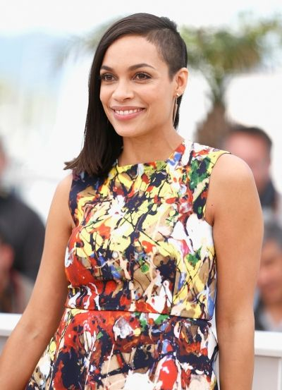 Rosario Dawson's half shaved hair gives her the chic but rebellious look.