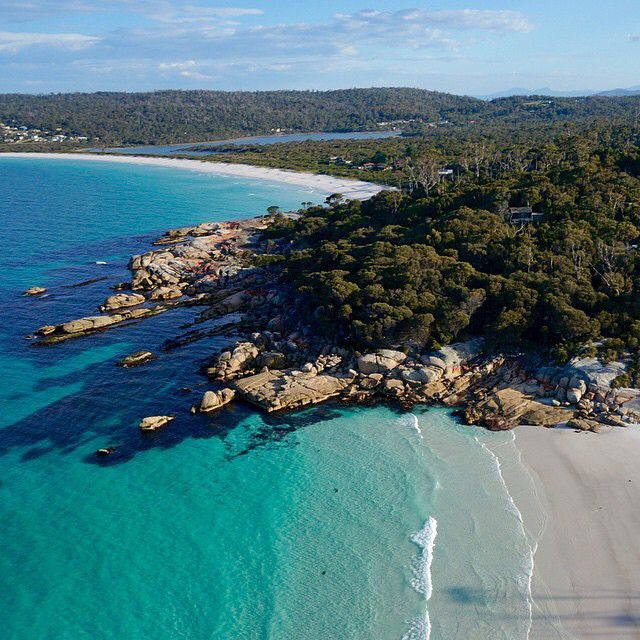 A breathtaking aerial view of Binalong Bay, on Tasmania's East Coast, thanks to @choppercamtas. This small beachside community at the southern end of the Bay of Fires boasts beautiful stretches of dazzling white sand and clear water that has been luring holiday makers for decades. It's no surprise the area offers all kinds of outdoor activities, from scenic coastal walks and beachside fun to some of the world's best game fishing. Or you could just sit on one of the secluded beaches and do…