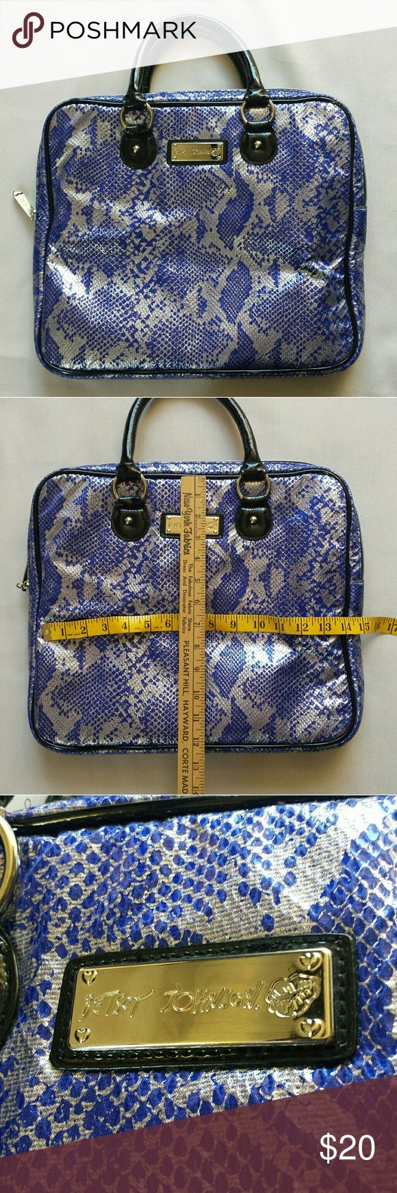 Betsey Johnson laptop tote bag Betsey Johnson laptop tote bag. Metallic blue and white snakeskin look. Approximately 12 x 14 x 1.5. Inner pockets on both sides. Great pre-owned condition. Betsey Johnson Bags Laptop Bags