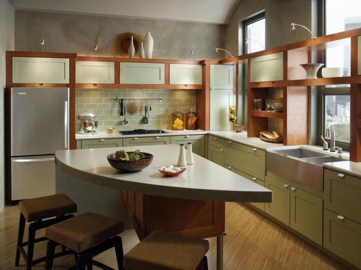 An open shelf above the sink integrated with closed cabinets adds extra storage in this smaller kitchen. Photo courtesy of KraftMaid