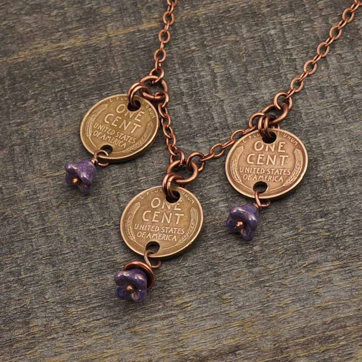"""This necklace measures 19.5"""" (49.5cm), and it features a trio of US wheat pennies and lavender Czech glass flower beads. The jump rings are made of antiqued copper and enameled copper. The chain and headpins are made of antiqued copper. The toggle clasp and beadcap are made of copper plated leadfree pewter. Wheat pennies measure 3/4"""" in diameter (19mm). These are dated 1941, and 1942."""