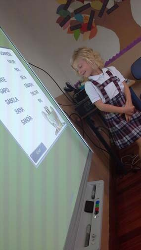 They love the frog lesson activity on a SMART Board!