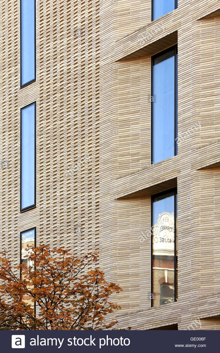 Detail of brick facade with window reveal. Turnmill Building, London, United Kingdom. Architect: Piercy & Company, 2015. Stock Photo
