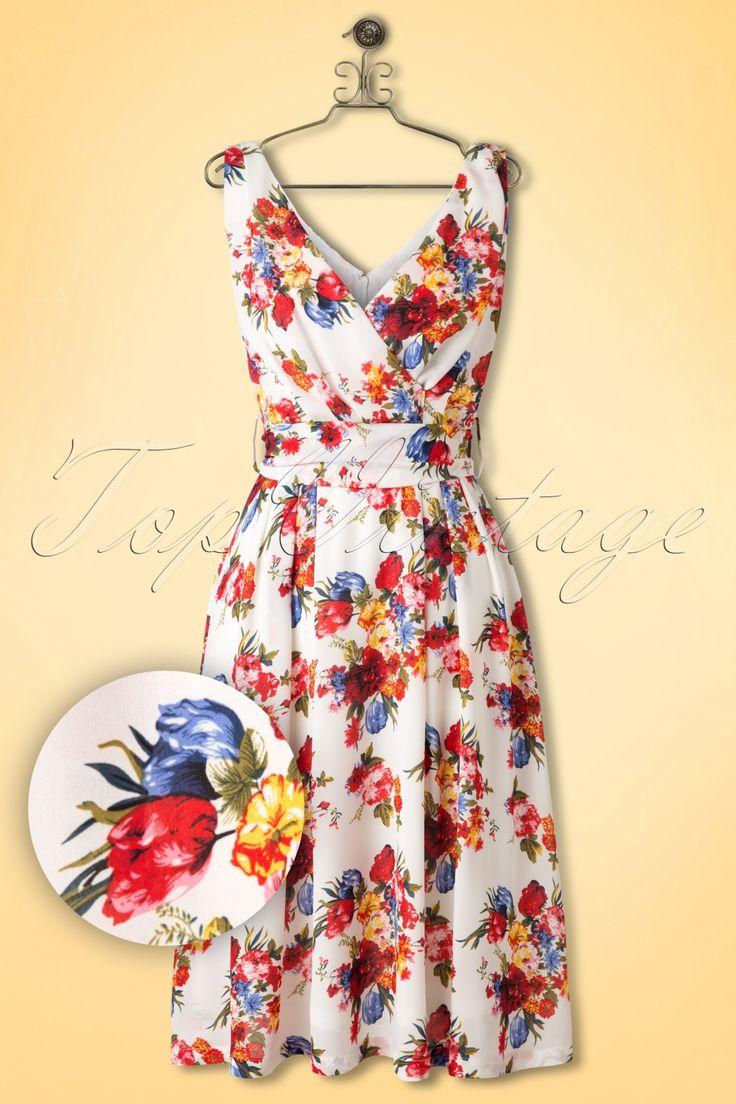 De50s Josephine Floral Fit and Flare Dress in Ivoryvan Lindy Bop is een klassieke fleurige jurk, die je ook nog een handje zal helpen op je date met de prins op het witte paard!Met dit schatje word je omhelst door prachtige bloemen! De mouwloze top heeft een V-halslijn aan zowel de voor- als achterkant en een prachtige geplooide overslag. De afneembare strikband accentueert je taille mooi en maakt het geheel af. Vanaf de taille uitlopend in een flatterende semi-swing rok die gesch...