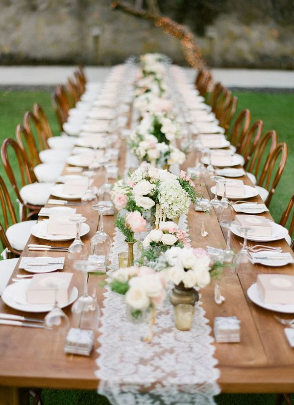 very gorgeous and lovely rustic glam outdoor wedding decoration. Use lace table runners, vases and beautifully arranged flowers to achieve this look. This is perfect for huge parties