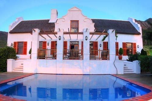 Oudekloof is a charmingly restored Cape Dutch farmhouse, nestled on the slopes of the Obiqua mountains. It has four en-suite bedrooms, and one double bedroom in the main house, with a large kitchen, wrap-around verandah, pool, and outdoor braai area for entertaining.