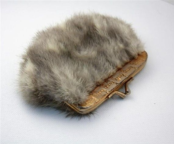 Rabbit Fur Coin Purse.  Rabbits died so that some idiot could have something pretty to put their pennies in.