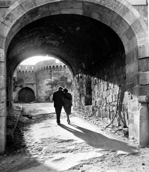 A couple walking through an archway in Belgrade, 1948, Walter Sanders.