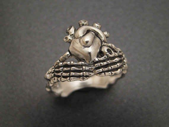 14 Beautiful Ways To Wear The Claddagh Design - kinda like this one - anatomically correct but still a claddagh.