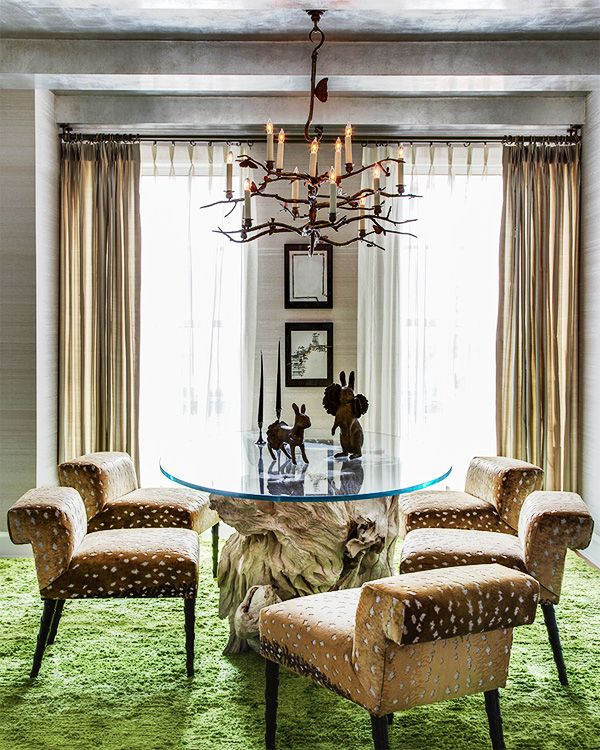 For afairy-tale forest-like dining space, Leifer chose a tree-stump table fromAndrianna Shamaris and a Claude Lalanne twig chandelier.