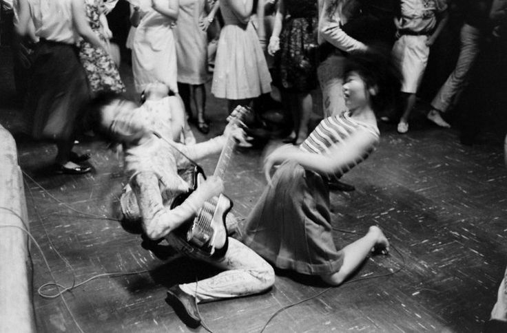 """TEENAGE WASTELAND: JAPANESE YOUTH IN REVOLT, 1964 — Michael Rougier — A fan (right) and a """"Tokyo Beatle,"""" 1964."""