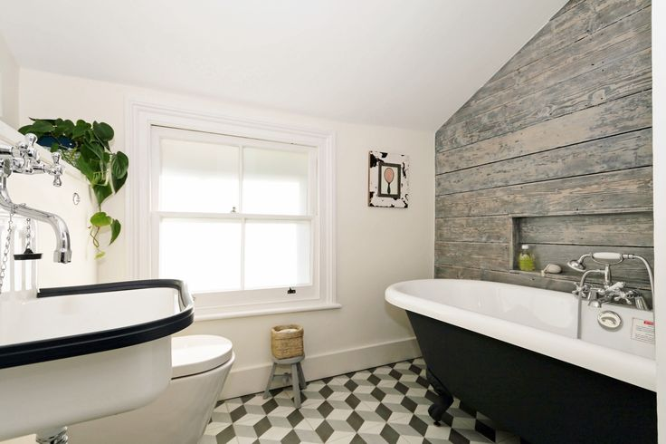 Top floor bathroom, 3d tiles, wooden feature wall, bucket sink from Labour and Wait and a lovely large painted roll top bath