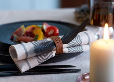 "Towel Napkin ""Malin Black"" with leather strap and feather"