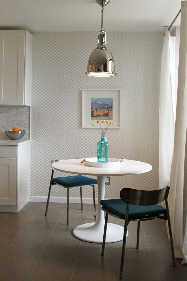 An Industrial Chrome Pendant Light Hangs Overhead, While Gray And White  Diamond Patterned Wallpaper Provides A Fun ...