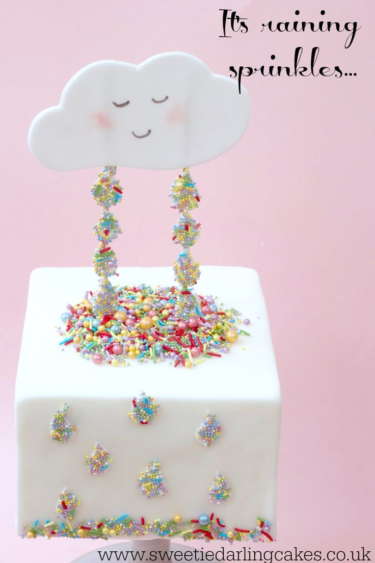 See how to cover a square cake in fondant and how to make an adorable Sprinkle Rain Cake in this easy-to-follow tutorial using rainbow sprinkles.