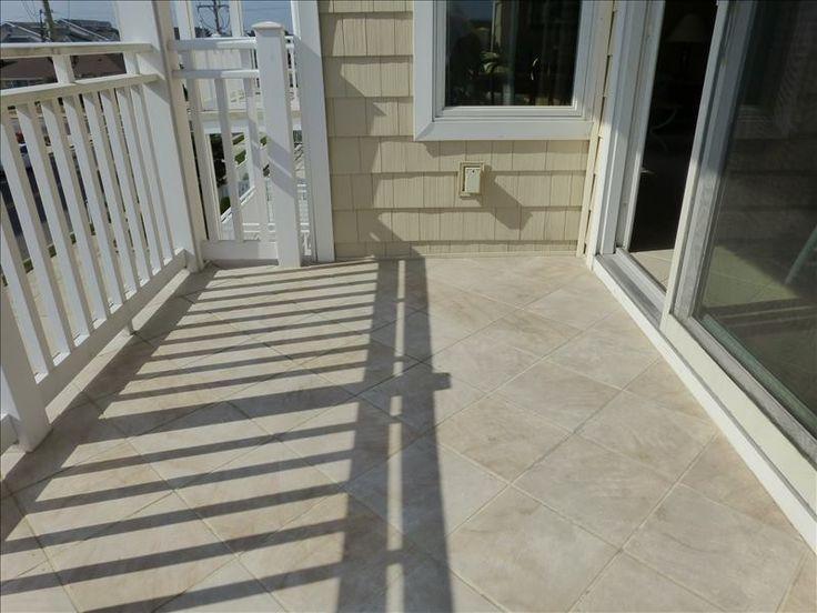 The balcony has ceramic tile flooring.