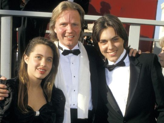 Jon Voight with son and daughter James Haven and a 13 year old Angelina Jolie at the 60th Academy Awards, 1988.