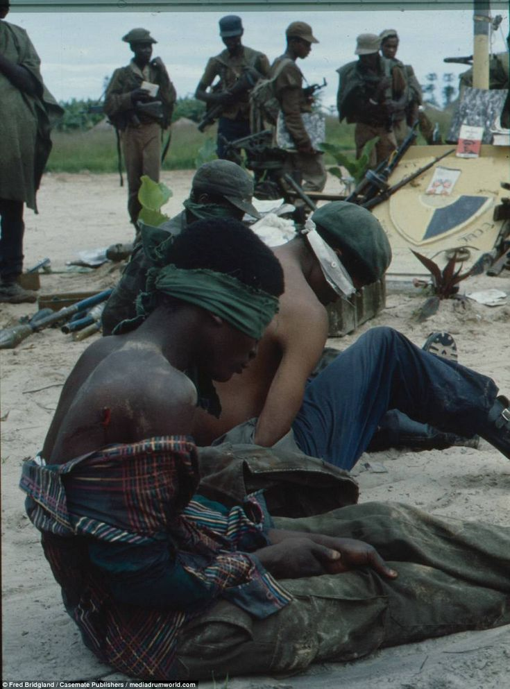The pictures also show soldiers from the Cuban-backed People's Movement for the Liberation of Angola after being captured and blindfolded by UNITA troops