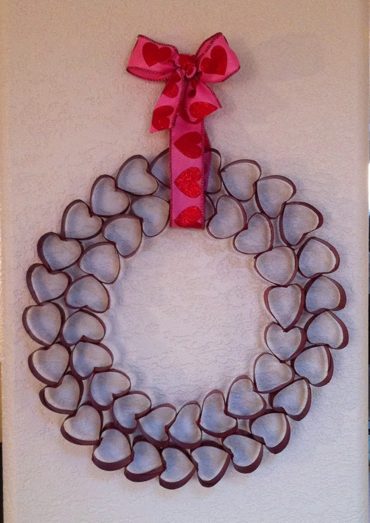 Valentines Day wreath made from toilet paper rolls and spray painted red.