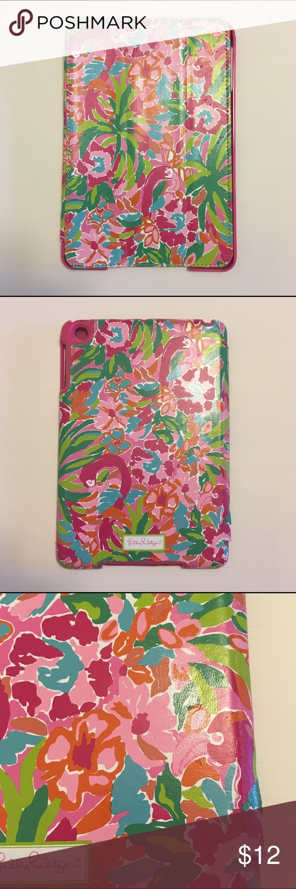 "Lilly Pulitzer iPad mini 1st generation case Pre-owned Lilly Pulitzer iPad case in ""Lulu"" print with pink microfiber lining. Fits 1st generation iPad mini. Magnetic cover triggers iPad's sleep/wake function upon opening. Has normal wear/scratches on outside covers (see pictures). Lilly Pulitzer Accessories Tablet Cases"
