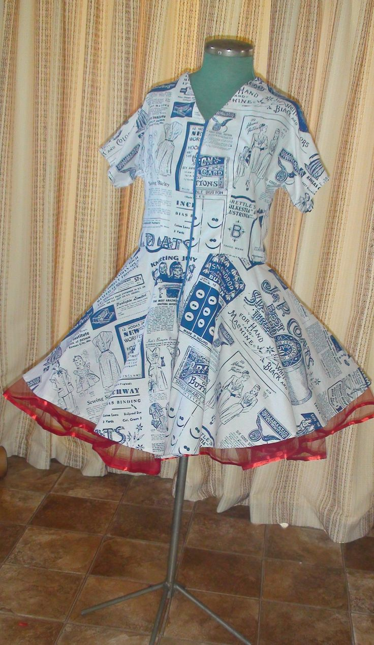 The fabric features vintage haberdashery ads.  The petticoat underneath is red tulle. {Made by Hour Glass Sewing}