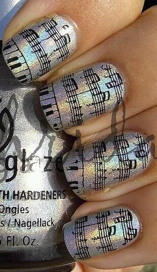 I wonder if you could use the same technique as the newspaper nails. But instead of newspaper sheet music.