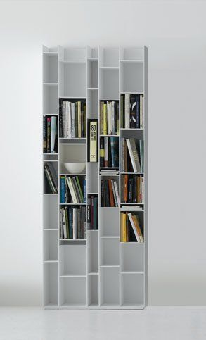 Random is a bookcase made of 6mm thick MD timber fibreboards, micro goffered lacquer in black or white. The back is made of melamine-coated board (thickness 10mm). The shelves are at various standard heights that fit into the back through    conceale...