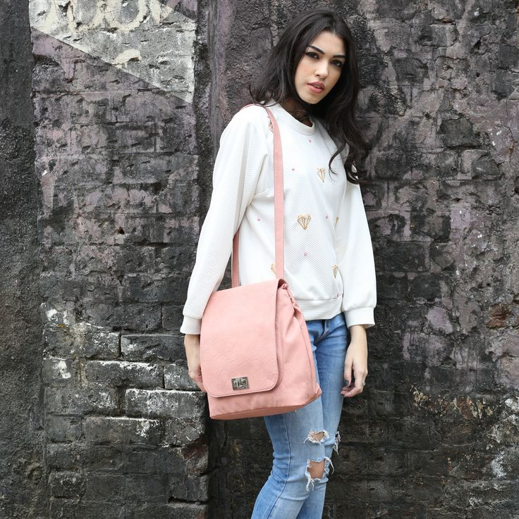 Slip on a pair of distressed denims, a comfy sweatshirt, pick up your #backpack and head out to embrace everything beautiful around you. This #pastel #backpack is available at any Exclusive Baggit Outlets and at www.baggit.com. #GetTheLook #womensfashion #Baggit #casuallook #womensbags