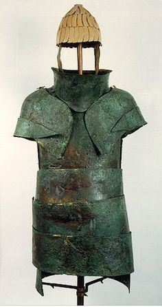 """Mycenaean panoply, Dendra Mycenaean cemetery, Tomb 12 (""""The Cuirass Tomb"""") LH IIB-IIIA1, 1400 B.C. Sarpedon might have fought in a suit of bronze armor similar to this. The helmet pictured was made of boars' tusks.  Archaeological Museum of Nafplion Nafplion, Greece"""