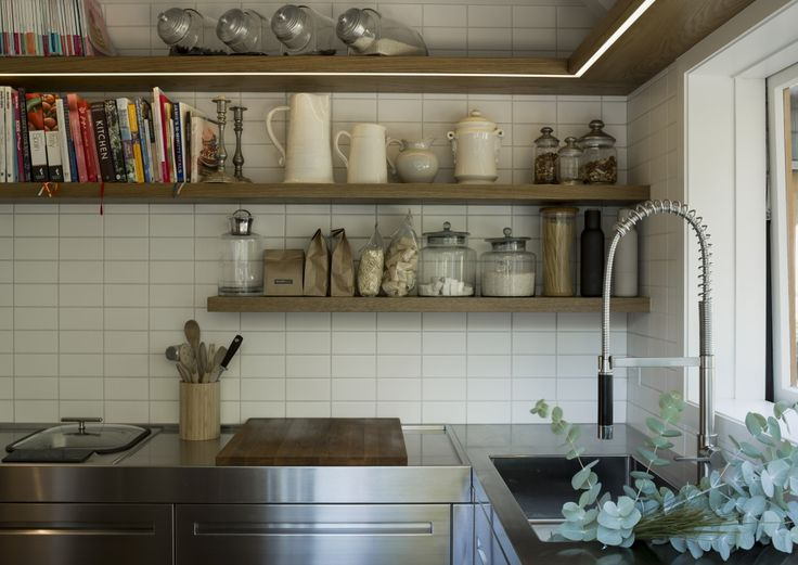 A great use of timber shelving with strip led lighting, breaking up the stainless steel adding warmth and a homely feel. Ohiti, Stainless Steel Kitchen by quattro: :uno » Archipro
