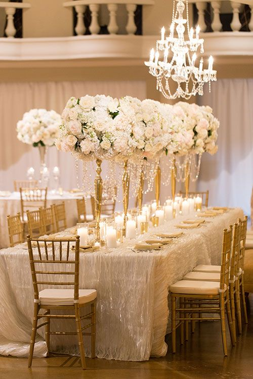 Tables with Tall White Floral Centerpieces   Brides.com