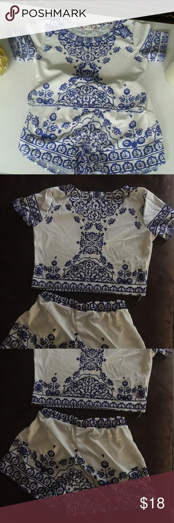 Cute 2 piece Adorable blue and white two piece! Short sleeve top and bottoms with front pockets. Shorts are stretchy. Top tag says Medium Shorts