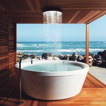 Stand alone bath with rain shower and fabulous sea views
