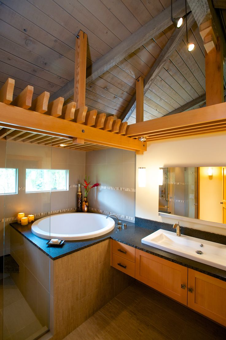 2014 Chrysalis Award Winner: Bathroom over $60,000. Open and airy with fir trellis defining bathing and vanity areas, this master suite was expanded into the adjacent guest bath.